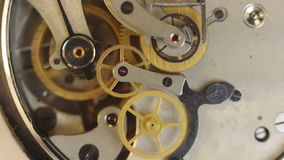 Metal cogwheels inside clockwork. Concept Eternity, Teamwork. Tick-Tick Sound stock footage