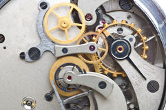 Metal cogwheels inside clockwork. Conceptual macro photo. Royalty Free Stock Photo