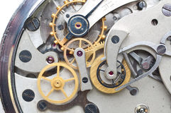 Metal cogwheels inside clockwork. Conceptual macro photo. Royalty Free Stock Photos