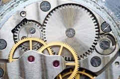 Metal cogwheels inside clockwork. Macro. Royalty Free Stock Photo