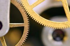Metal cogwheels inside clockwork. Macro Stock Image