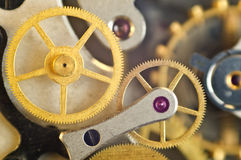 Metal cogwheels inside clockwork. Macro. Royalty Free Stock Photos