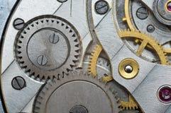 Metal Cogwheels in Old Clockwork, Macro. Stock Photo