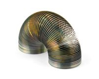 Metal coil toy. Isolated on pure white royalty free stock photo