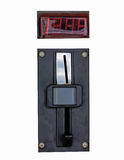 Metal coin slot panel from a coin operated machine with entry and exit slots and button on an isolated background Royalty Free Stock Photo