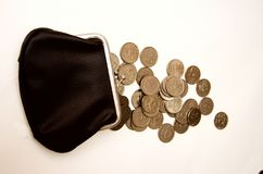 Black wallet with coins on a white background royalty free stock photo