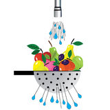 Metal colander and fruit Illustration of colander with fruit placed under the water Royalty Free Stock Photography