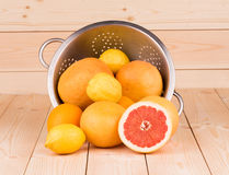 Metal colander full of grapefruits. Royalty Free Stock Image
