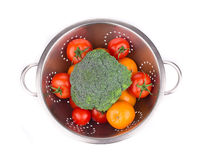 Metal colander full of vegetables. Stock Images