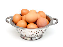 Metal colanger with eggs Royalty Free Stock Image