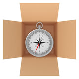 Metal compass with wind rose inside a cardboard Stock Photo