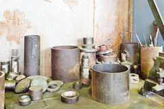 Metal components and workpiece on table Royalty Free Stock Photography