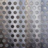 Metal con los agujeros Imágenes de archivo libres de regalías