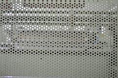 Metal con los agujeros redondos Fotografía de archivo libre de regalías
