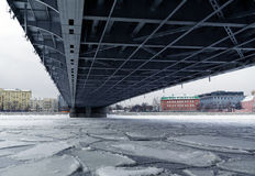 Metal construction of bridge span over the ice Stock Photo