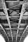 Metal construction of the bridge. View from below Stock Photos
