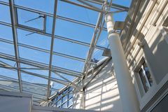 Metal construction of a glass roof on a sunny day Royalty Free Stock Photos