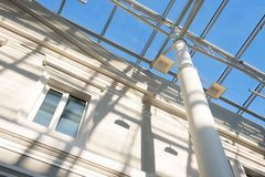 Metal construction of a glass roof on a sunny day Royalty Free Stock Image