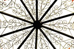 Metal construction, golden flower patterns on white background stock images