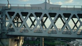 Metal construction multilevel highway for car traffic over river water in city. Metal construction multilevel highway road for car traffic over river water in stock footage