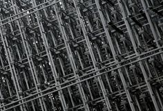 Metal construction pattern. Metal girders and beams in construction forming a pattern stock image