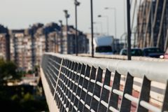 Metal construction on the steel cable bridge with traffic in the back royalty free stock images
