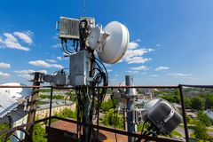 Metal construction for telecommunication data equipment or mast with microwave, radio panel antennas, outdoor remote. Metal construction for telecommunication royalty free stock photo
