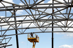 Metal construction. Two Construction workers on a construction ramp Royalty Free Stock Images