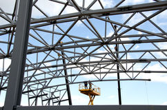 Metal construction. Two Construction workers on a construction ramp Stock Images