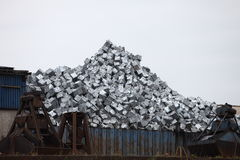 Metal container with recyclable waste. Metal container at a dump yard filled with a pile of sorted recyclable waste stock photos