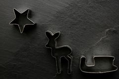 Christmas cookie cutter on black background Stock Image