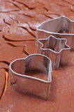 Metal cookie cutters and dough for gingerbread Royalty Free Stock Images