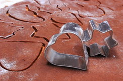 Metal cookie cutters and dough for gingerbread Royalty Free Stock Photos