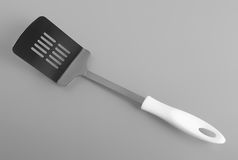 Metal cooking kitchen spatula Royalty Free Stock Photos