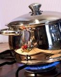 Metal cooking pan on gas burner Stock Photo