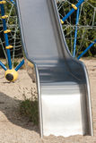 Metal a corrediça com escada de corda e o labirinto no fundo Foto de Stock Royalty Free