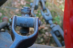 METAL COUPLING ON TRACTOR. Coupling device on an old tractor royalty free stock photography