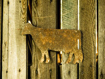 Metal Cow Decoration on Wood Stock Photo