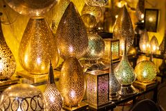 Metal crafts in Marrakech. Gold, silver and copper lamp pieces in the Market royalty free stock images