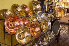 Metal crafts in Marrakech. Gold, silver and copper pieces royalty free stock images