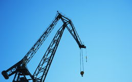 Metal crane with blue sky Stock Photos