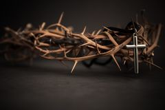 Metal cross with crown thorn. religion concept. Metal cross with crown thorn. religion concept royalty free stock images