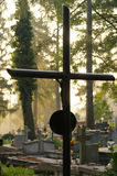 Metal cross on a graveyard Stock Photography