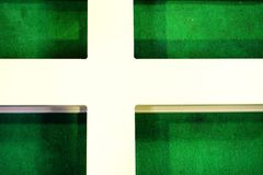 Metal cross on green carpet Stock Photography