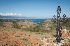 Metal cross on the hill, Baikal, Russia Stock Photography