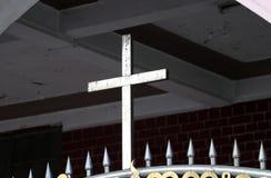 Metal cross on the Iron fence stock photo