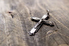 Metal cross lying on the table Royalty Free Stock Image