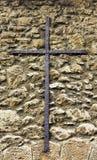Metal cross on monastery wall Stock Image