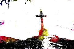 Metal cross monument standing on a hillside Royalty Free Stock Photography
