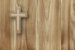 Metal cross on a wooden background Royalty Free Stock Photo